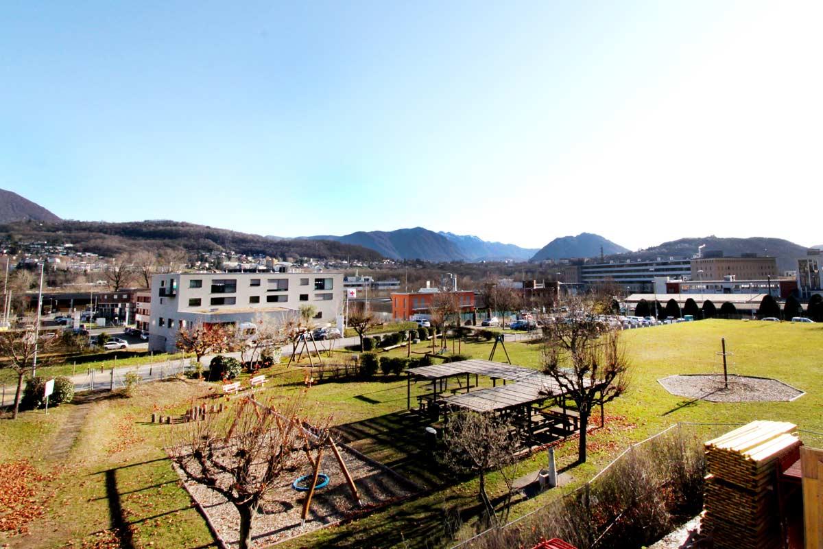 Manno-Norello-ch-parco-vista-da-edifici